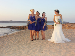 Angie and the bridesmaids having some fun on the sandy beach